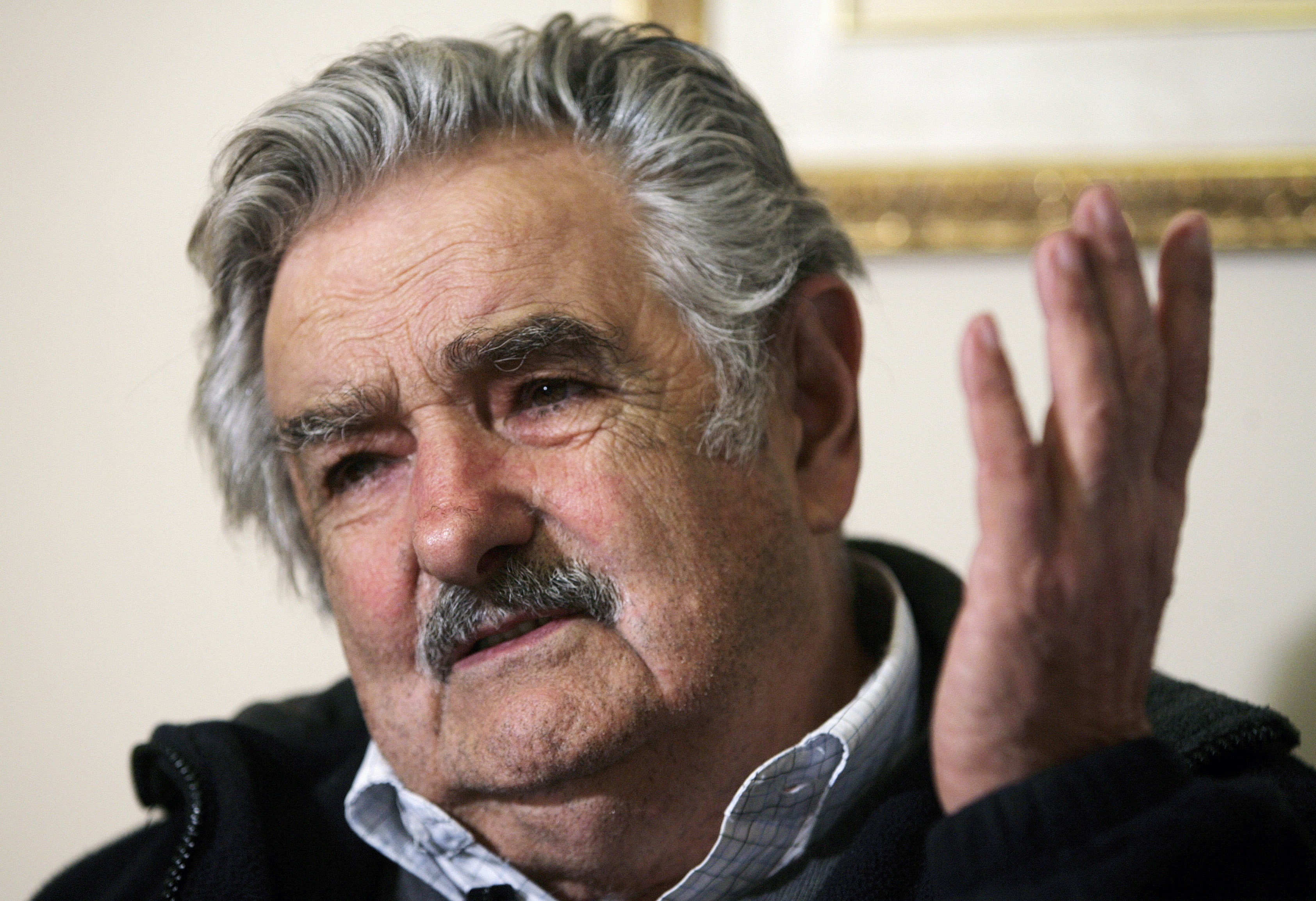 Former guerrilla leader and Uruguay's leading presidential candidate Jose Mujica gestures during a Reuters interview in Montevideo